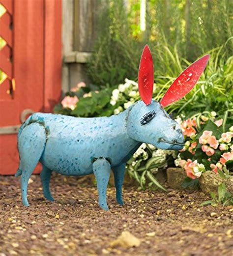 welded metal garden sculptures add personality to your