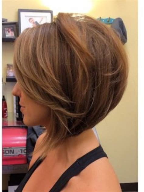 stacked bob haircut long points in front cut inverted bob with side swept fringe though hate