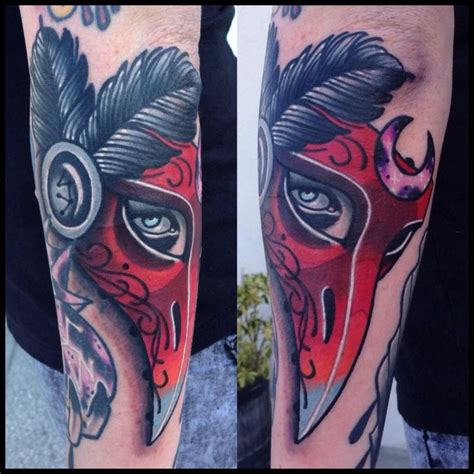 animal tattoo melbourne victorian raven masquerade mask tattoo done by stockton