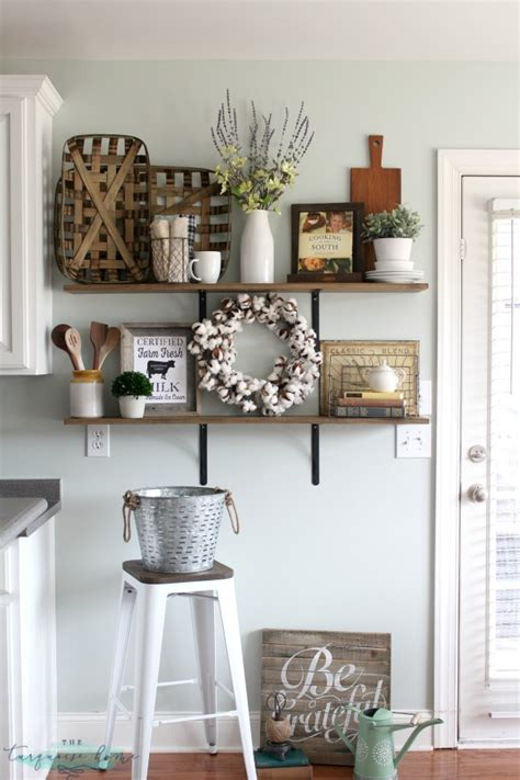 farmhouse style home decor decorating shelves in a farmhouse kitchen