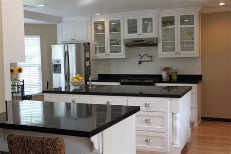 white cabinets white countertop dark granite countertops hgtv inside kitchen ideas white