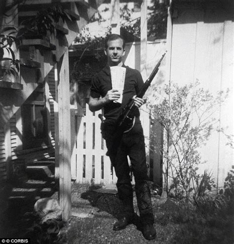 kennedy and oswald the big picture books photograph of harvey oswald holding gun he used to