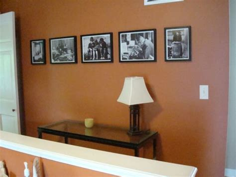 black white photos on burnt orange wall color home design and style orange