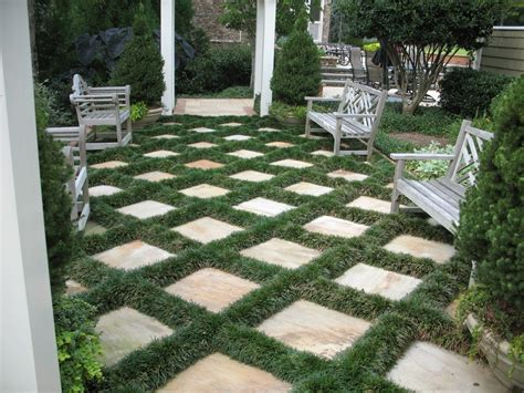 mondo grass and pavers patio traditional with garden bench