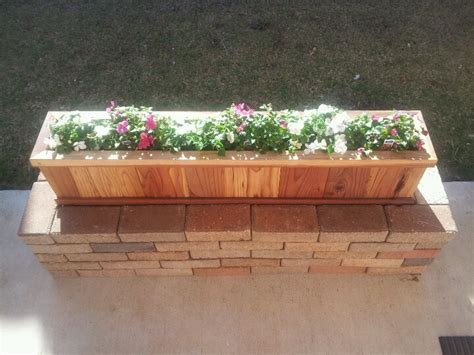 flower planter i made from brick walkway and a home