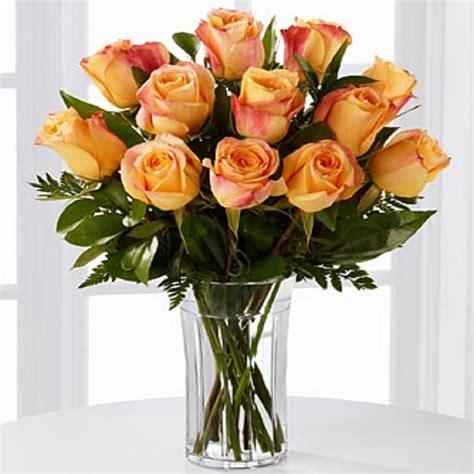 floreros s a floreros 12 rosas ecuatorianas naranjas flormorena