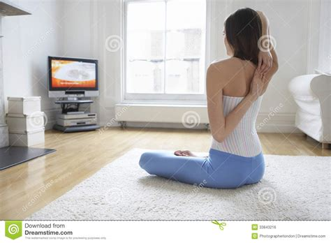Karpet Fitnes arms and tv at home stock photo image 33843216