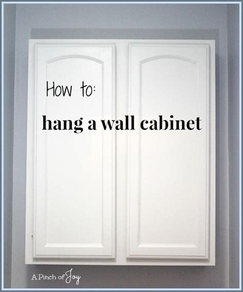 how to hang a wall cabinet the easy way