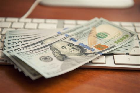 on computer money on computer keyboard answering