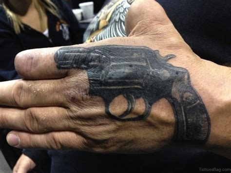 gun tattoos on hand 28 funky gun tattoos on
