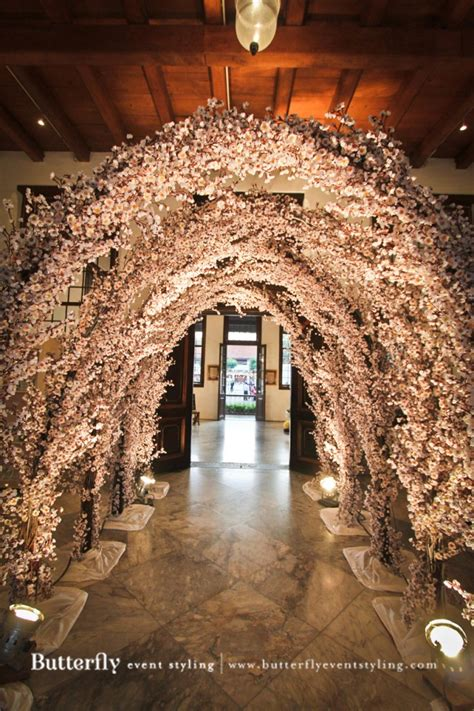 Wedding Arch Tree Branches by Wedding Arch With Flowers Butterfly Event Styling