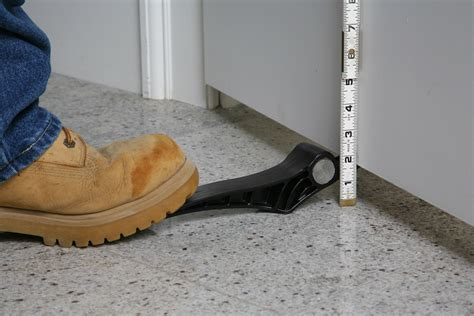 Door Hanging Tools foot activated doorjack makes it simple for one person to