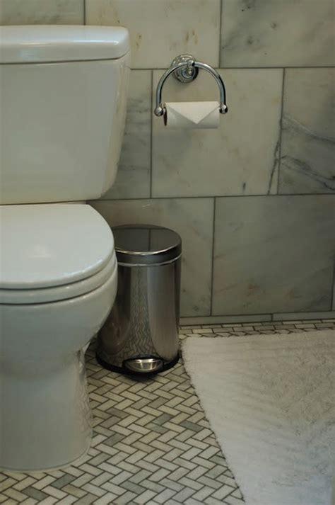 herringbone tile floor bathroom marble herringbone floor transitional bathroom 12