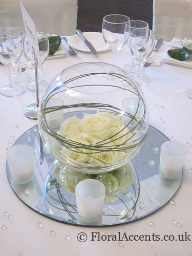 Wedding flowers   glass fishbowl table centres with a dome