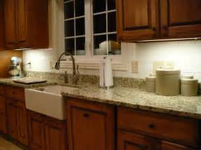 Stainless steel sink white drainboard and granite countertop on the