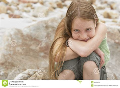 Cute Preteen | cute preteen girl sitting on rock royalty free stock