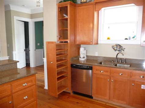 kitchen brown wooden pantry cabinet with doors and