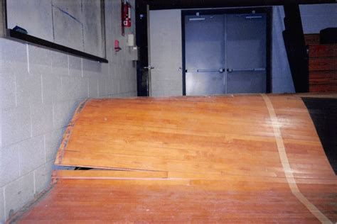 Water Damage on Gym Floor   Flooded Basketball Court   Gym