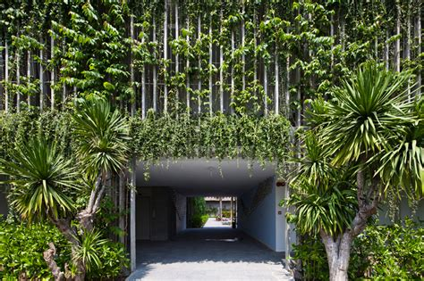 designboom resort vo trong nghia blends greenery with concrete louvers in