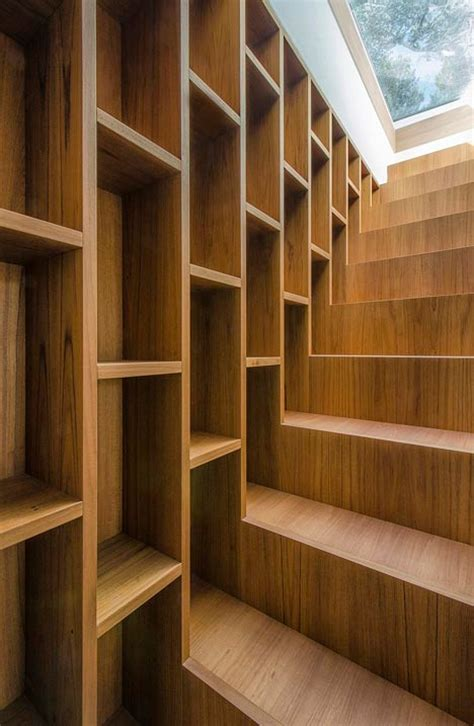 staircase bookcase warm functional storage area