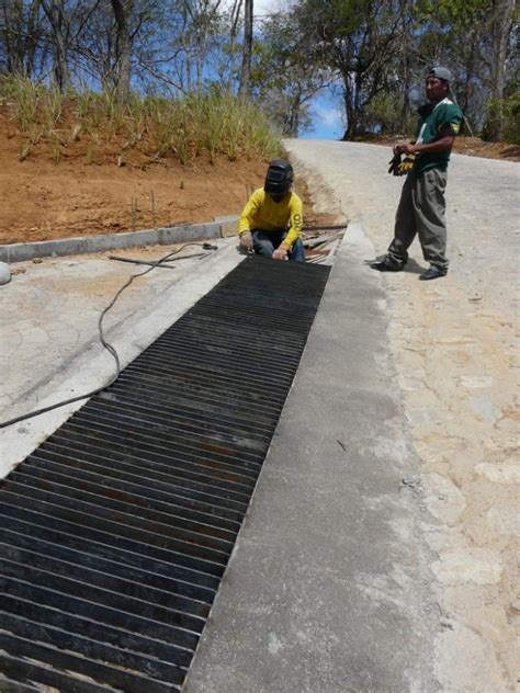 grate drainage for the top of the driveway at the road