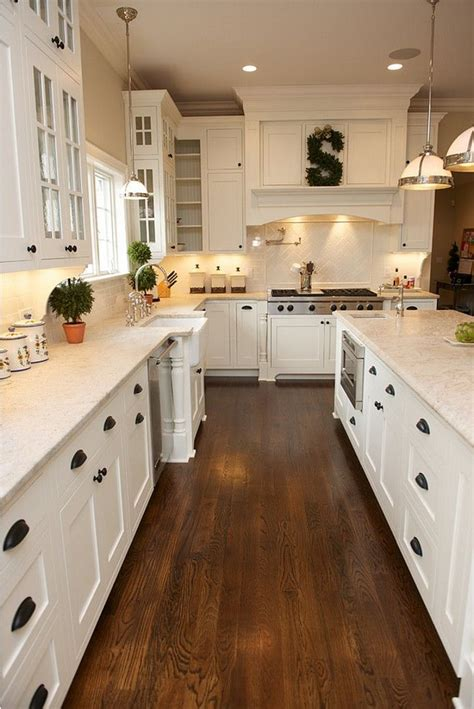 kitchens with wood floors 25 best ideas about white kitchen cabinets on