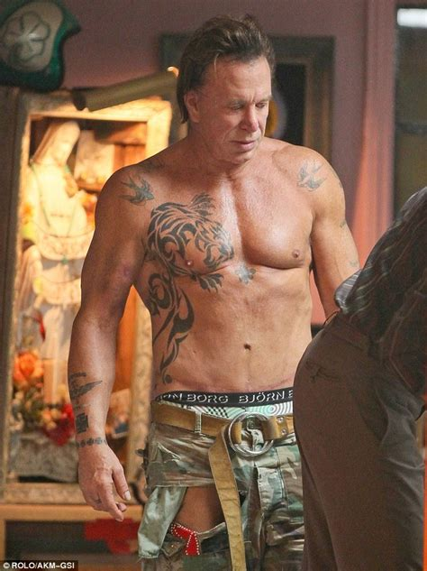 mickey rourke whips off his shirt to get another tattoo