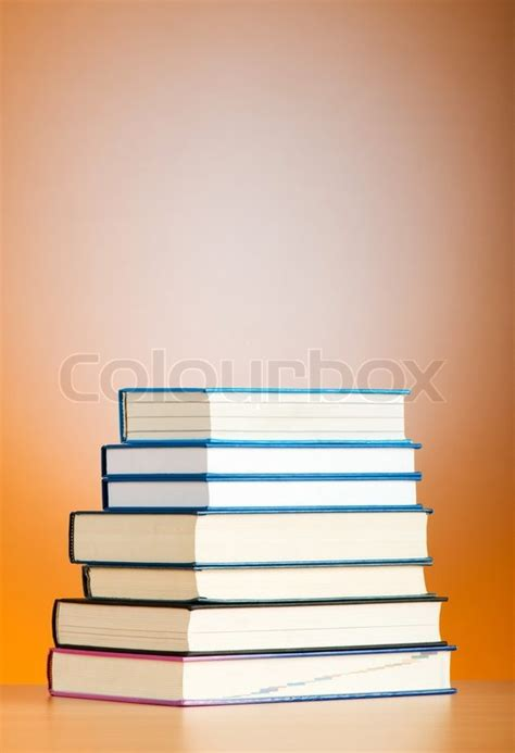 gradient books stack of text books against gradient background stock