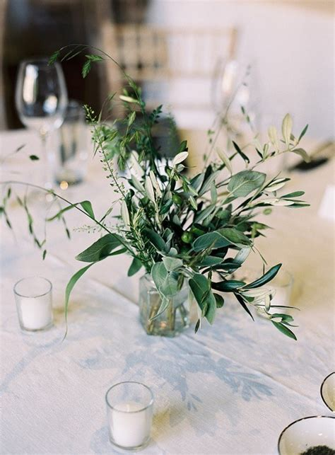 trending  chic white  green wedding centerpiece ideas   day