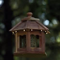 lighted houses lighted cedar gazebo bird feeder the green