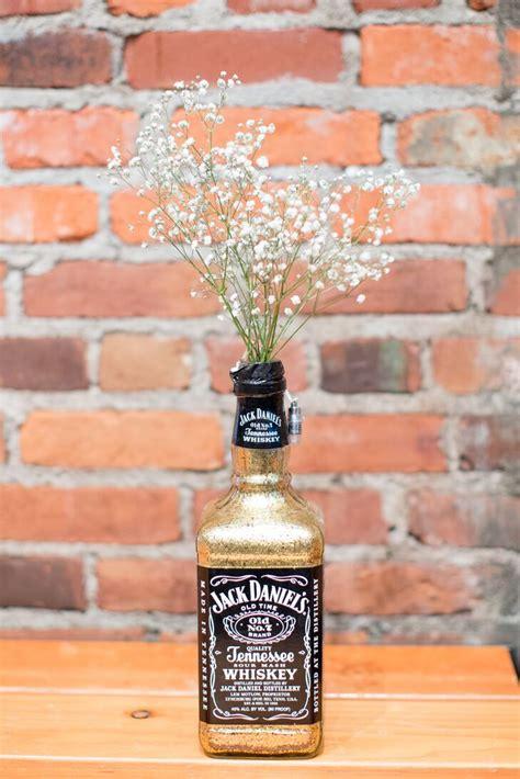 glamorous jack daniels bottle centerpieces