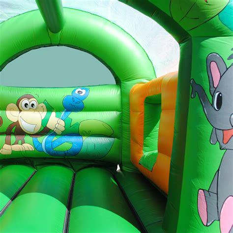 jv bouncy castle hire basingstoke and inflatable slide 15 x 18ft jungle bouncy castle and slide combi jv bouncy