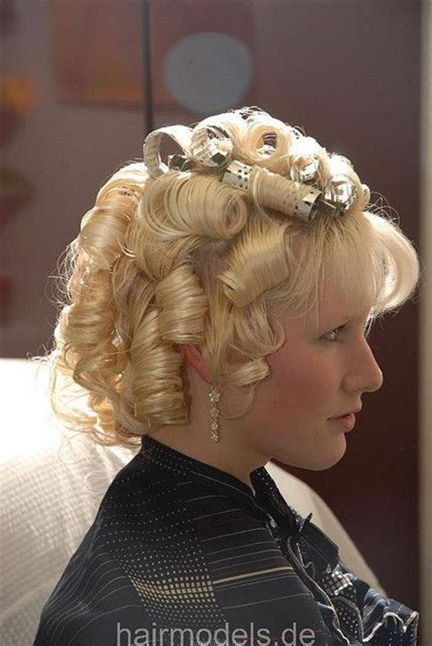 wife setting husband hair in curlers husband with hair in curlers husband feminization