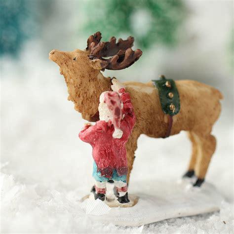 miniature santa and reindeer christmas figurine