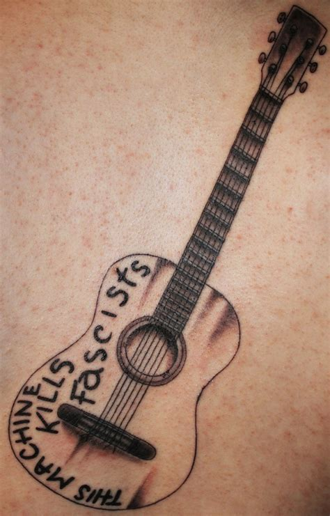 simple guitar tattoo design nice tattoo of woody guthrie s guitar clean and simple