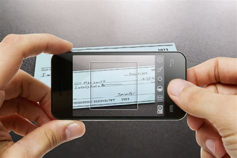 mobile bank deposit photo based mobile check deposits heading to u k