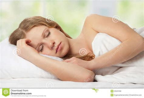 woman on woman in bed beautiful young woman sleeping in bed royalty free stock