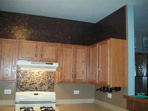what to do with the space above kitchen cabinets ideas on what to do with the space above my kitchen