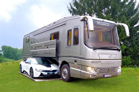volkner mobil bespoke rv hides sports car in mobile garage curbed