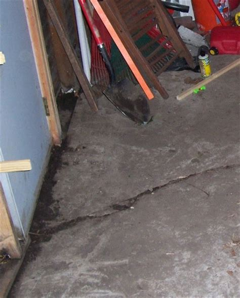 Cracked Garage Floor by Foundation Repair Costs Arlington Dallas Fort Worth