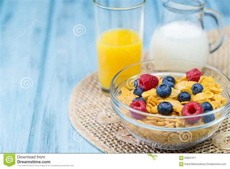 Ejuice Matjan Breakfast Berry Cereal Milk bowl of cereal with berries glass of orange juice and jug of milk stock image image 63821211