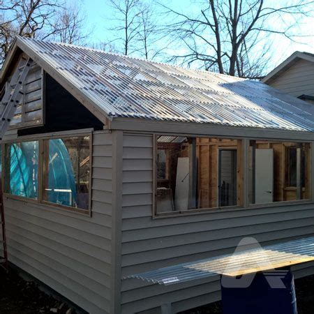 residential home   attached greenhouse roof greca