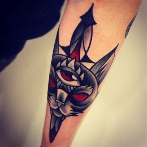 cat knife tattoo old school mystical demonic cat tattoo on forearm with old