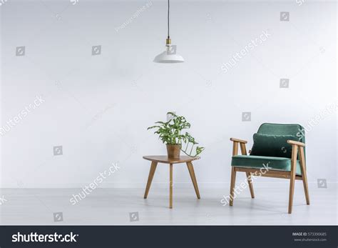 white room green armchair small table stock photo