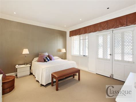 bedroom with brown carpet classic bedroom design idea with carpet french doors