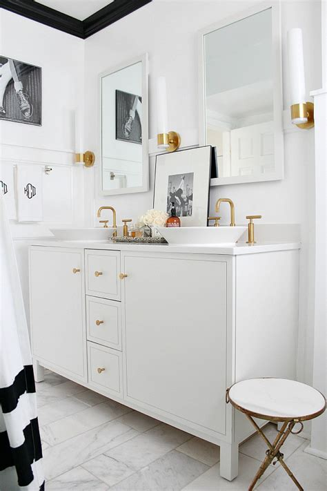 gold and white bathroom brass in the bathroom is back jenna burger