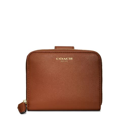 Coach Legacy Leather coach legacy leather medium zip around wallet in brown brass cognac lyst