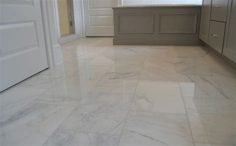 white carrara marble floor transitional wall and floor tile philadelphia by lqdesign studio