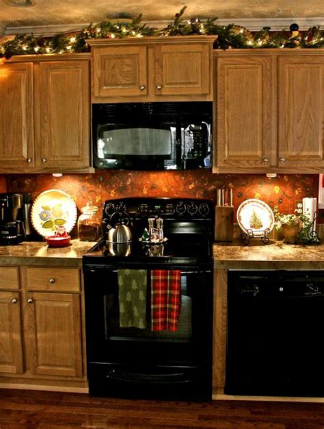 garland above kitchen cabinets garland on plant shelves or above kitchen cabinets i could do both it s a