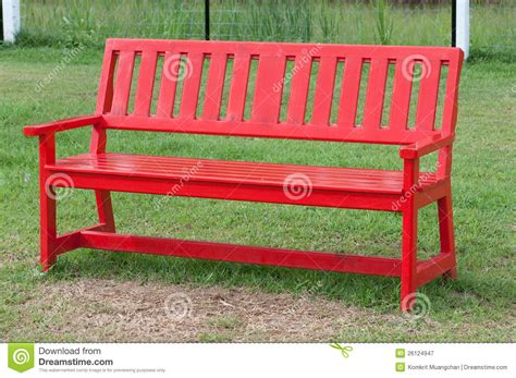 red park bench lonely wooden bench in the park royalty free stock